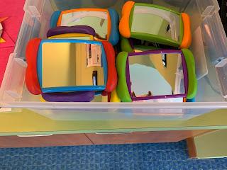 plastic bin full of handheld colorful mirrors