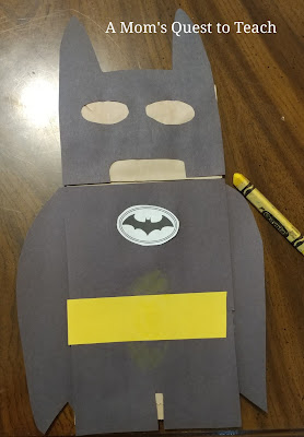 Batman paper bag puppet almost complete; missing googly eyes