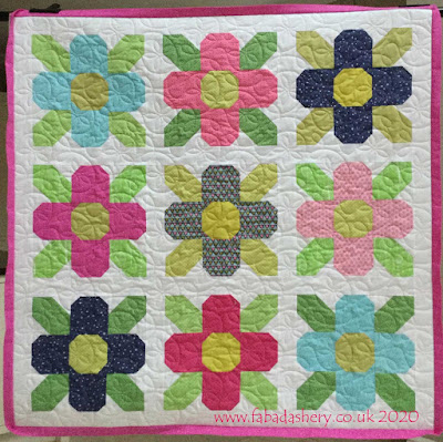 'Petal Power' designed by Kristina Brinkerhoff ,  made by Sue, quilted by Frances Meredith