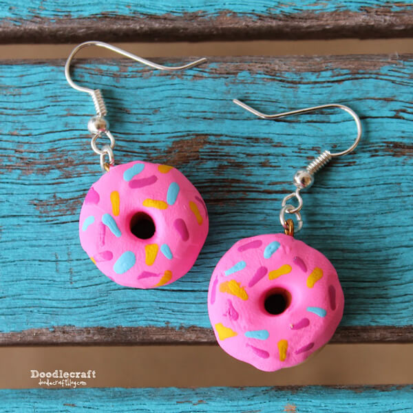 Donut earrings made with polymer clay and painted pink with sprinkles