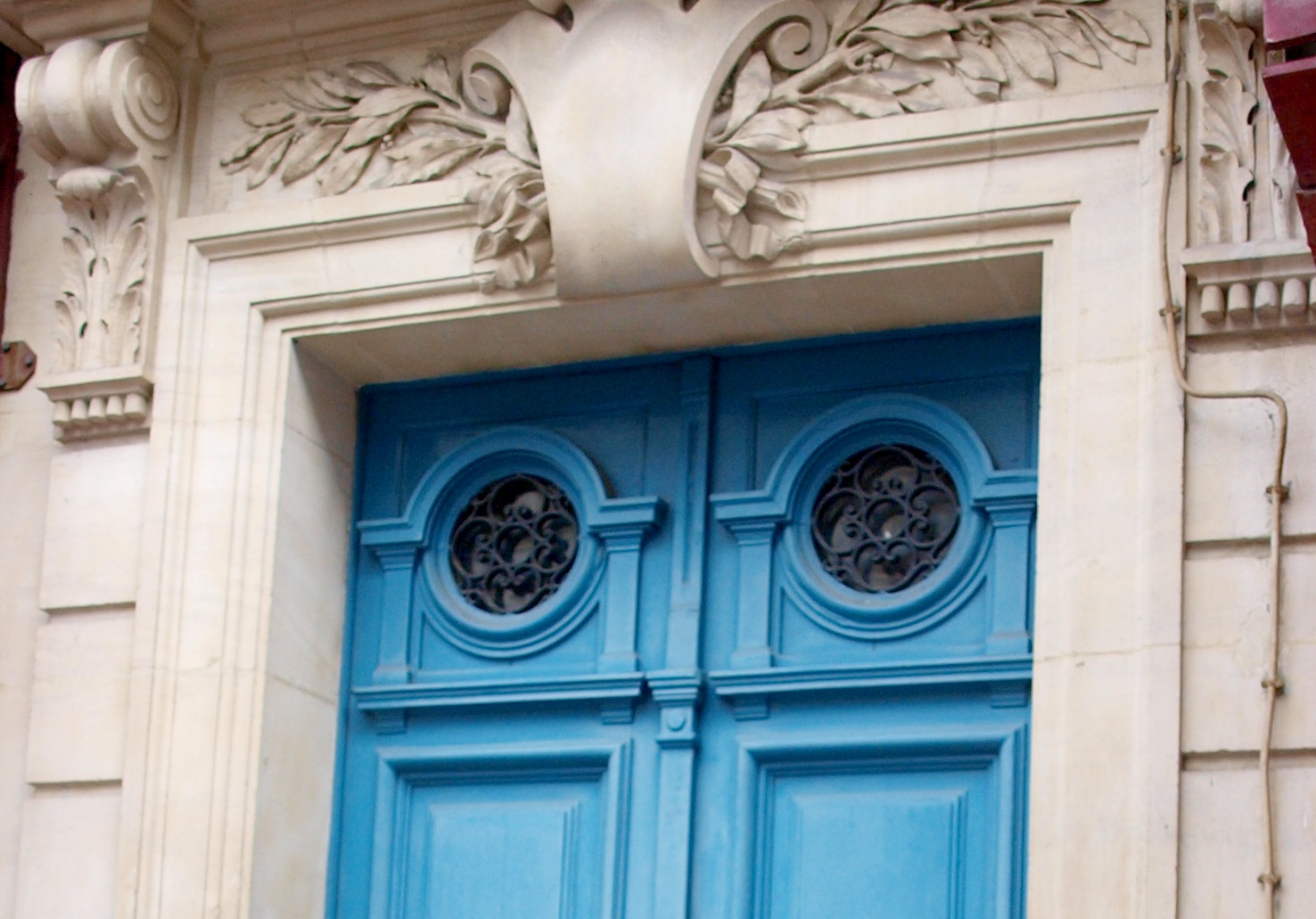 Vivid blue exterior double #doors on limestone #Parisapartment by Hello Lovely Studio