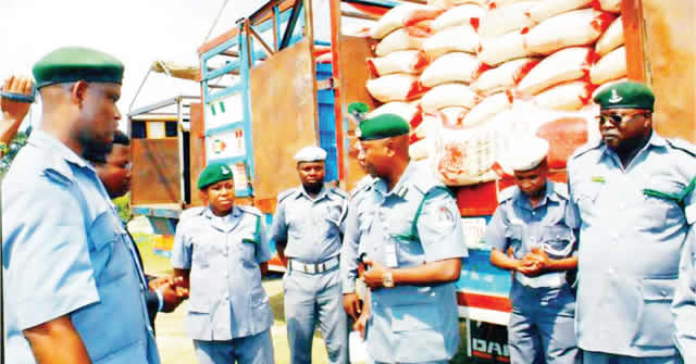 Criminals smuggling rice into Nigeria with caskets, gas cylinders – Customs