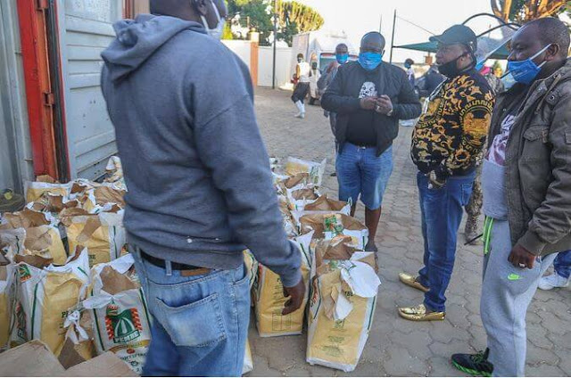 Nairobi governor Mike Sonko distributes food at his rural home, Mua, Machakos county.