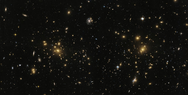 This image from the NASA/ESA Hubble Space Telescope shows the northern part of the galaxy cluster Abell 1758, A1758N. The cluster is approximately 3.2 billion light-years from Earth and is part of a larger structure containing two cluster sitting some 2.4 million light-years apart.  But A1758N itself is further split into two sub-sections, known as East (A1758NE) and West (A1758NW). There appear to be disturbances within both of these sub-sections — strong evidence that they are the result of smaller clusters colliding and merging.  Credit: ESA/Hubble, NASA