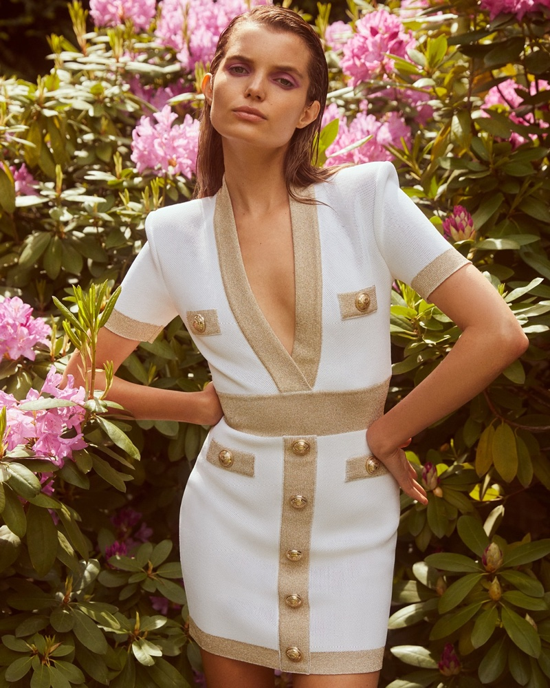 Michelle Van Bijnen wears bodycon knit dress in Balmain x MyTheresa summer 2020 campaign.