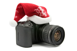 Photo of a camera with a Santa hat on top