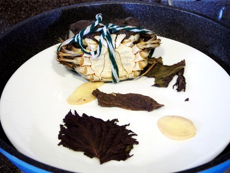 steaming hairy crab with perilla leaves ginger