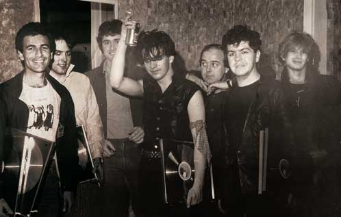 L to R: Chris Parry (The Cure's manager and MD of Fiction Records); Robert Smith; Murray Thom (MD of CBS NZ); Cure bassist Simon Gallup; Terry Condon (MD of Stunn Records and NZ subsidiary Reaction Records); Cure drummer Lol tolhurst; Trevor Reekie