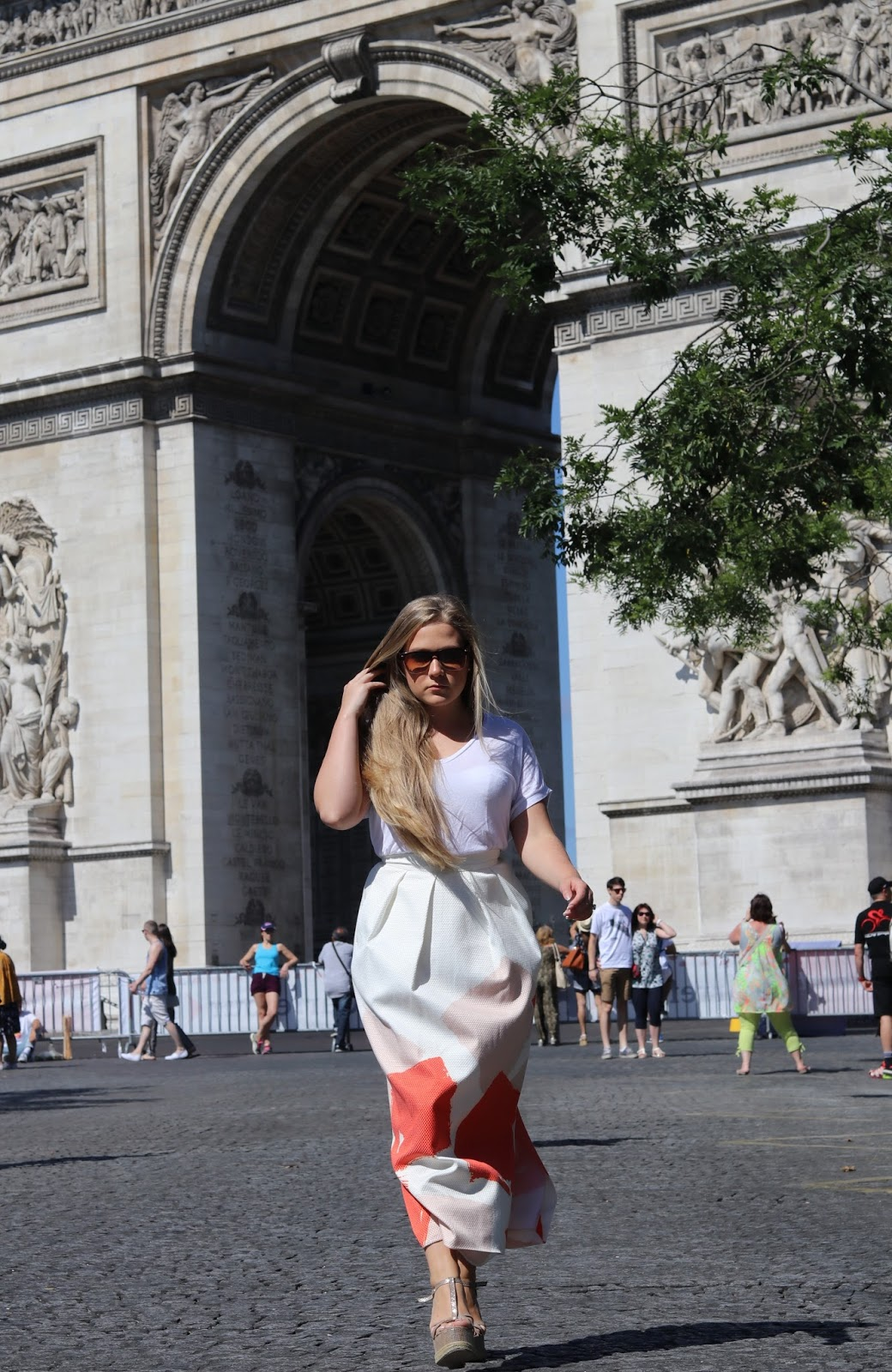 Katie Heath wearing an L.K.Bennett skirt outside the arc de Triomph