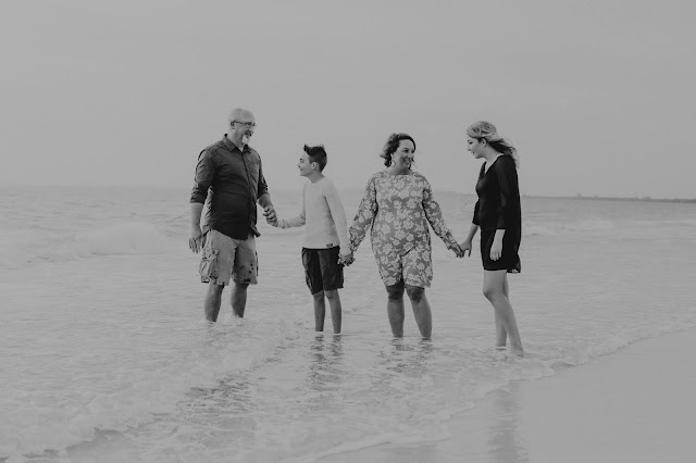 family in the water at the beach
