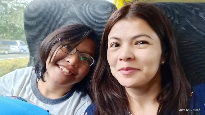 sitting in the bus, mother and daughter