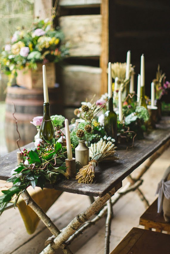 Megan s Parties   Good Eats  Holiday Party Decor Ideas     holiday party decor ideas  I love the winter greenery against the brown  wood table  I also like the idea of putting candles in empty wine bottles
