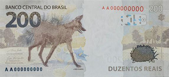 A  foto mostra a Cédula de R$ 200, mais uma da família do Real,  homenageia o lobo guará.