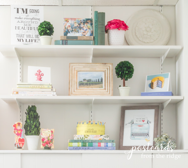 white shelves with ceiling medallion and cottage decor