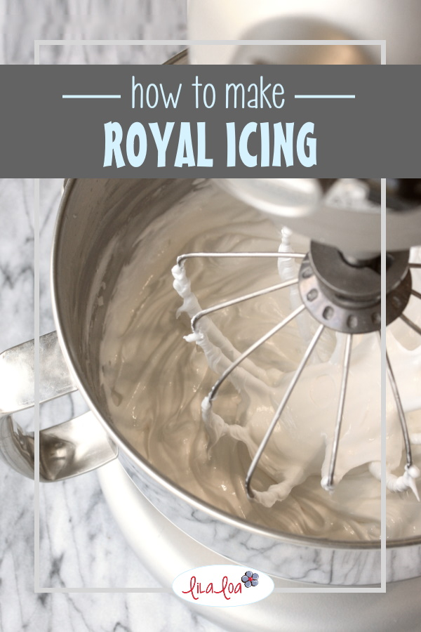 Creamy white whipped royal icing in a standing mixer