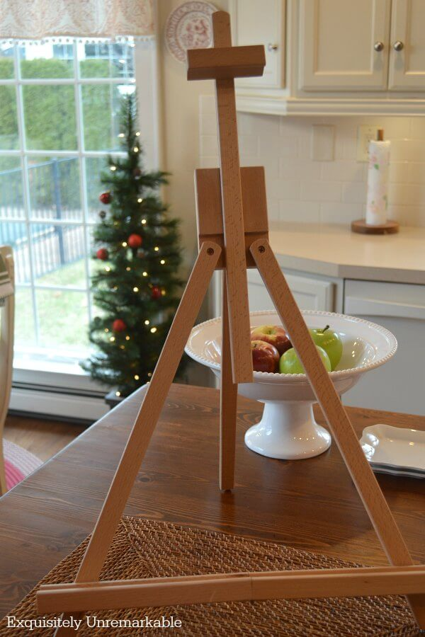 Mini Tabletop Easel on a table top at Christmas time with tree in background