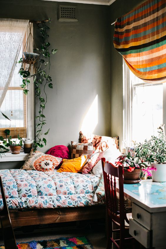 Pretty textiles, color, and plants in this bohemian bedroom