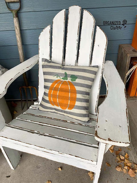 Photo of a striped pillow with fall pumpkin stencil.