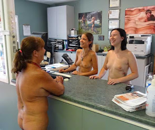 Staff members at the front desk in the office at Bare Oaks Family Naturist Park
