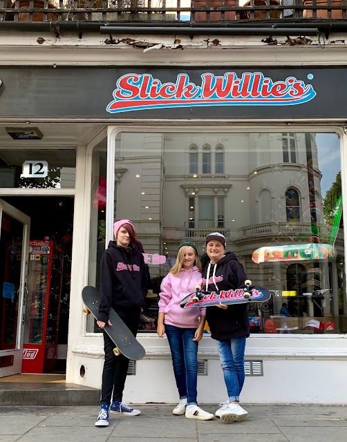 madmumof7 and daughters outside Slick Willie's skate shop in London