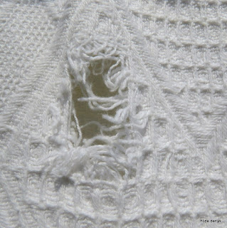 Hole in the cotton blanket