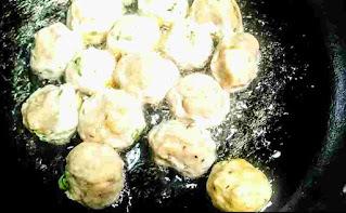 Frying chicken balls in a pan for chicken manchurian
