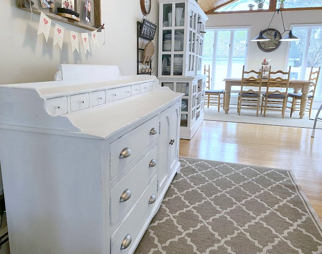 Farmhouse styled home with a painted sideboard