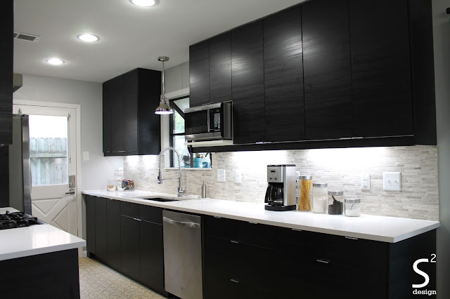 Though You See A Lot Of Black In This Chic Kitchen, We Were Sure To Install  LED Lights Under The Cabinets To Illuminate The Counter Work Space.