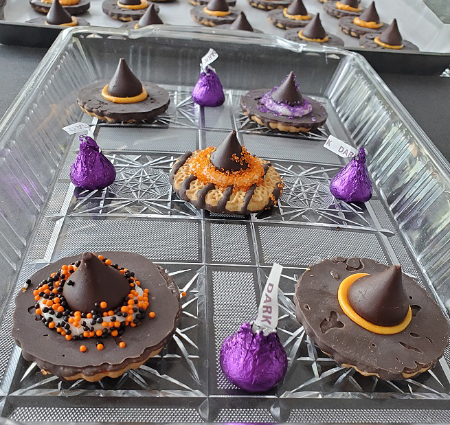 these are witch hat halloween cookies made with fudge strip cookies and kisses made out of chocolate with sugar colored sprinkles