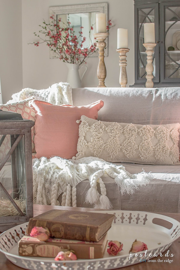 cozy pillows on a slipcovered sofa