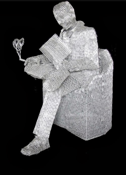 11-After-a-Hard-day-at-Work-Italian-Artist-Pietro-DAngelo-Paper-Clips-Sculptures-www-designstack-co