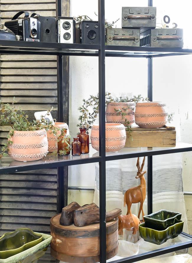 cool terra cotta vases and amber bottles