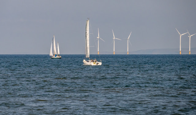 Photo of Mistral and Raingoose by part of Robin Rigg Wind Farm on the Solway Firth