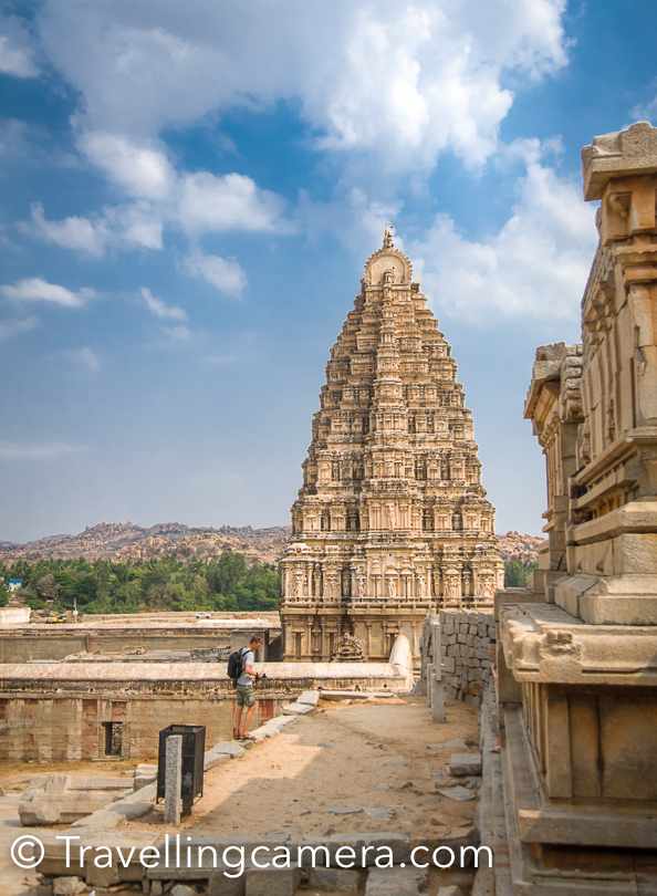 Virupaksha Temple has been considered the most sacred sanctuary over the centuries and one of the important pilgrimage place. This place is intact among the surrounding ruins and is still used in worship. There is also a Virupakshini Amma temple (mother goddess) in a village called Nalagamapalle, Chittoor district, Andhra Pradesh, approximately 100 km from Tirupati.   Inside the temple, there is an elephant who blesses every person entering into the temple. There is a hill around Virupaksha temple which has huge rocks placed all across. They make a great place to click photographs. The main photograph of this post on the top is clicked on the same hill.