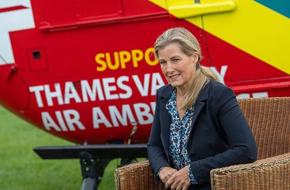 Dressed in a smart-casual ensemble of a blazer, a printed blouse and jeans. Sophie visited her patronage Thames Valley Air Ambulance