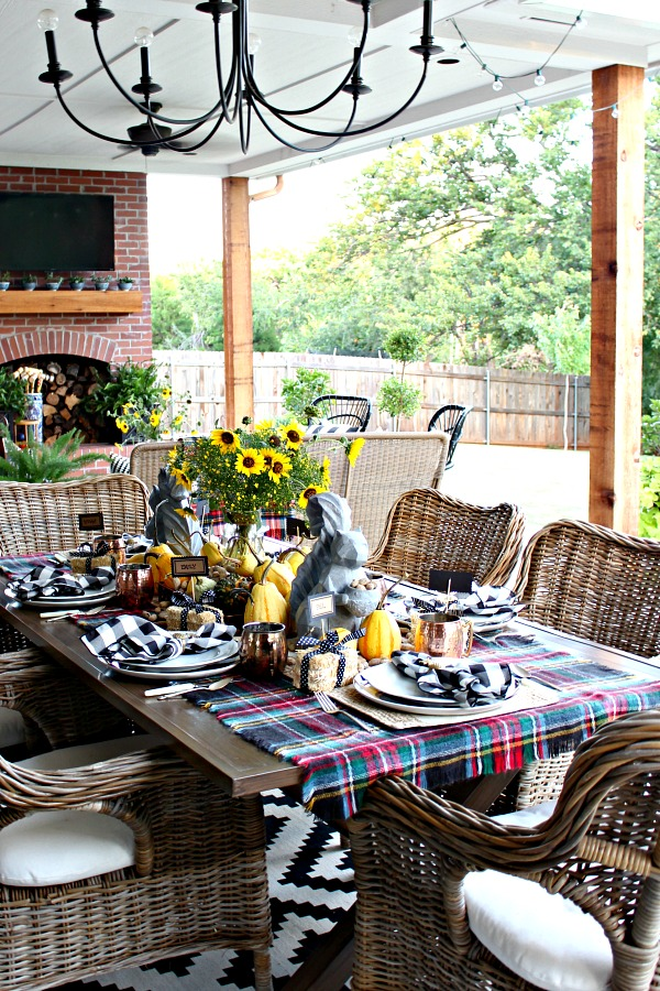 outdoor dining area, fall decorations, fall table setting, wicket chairs, outdoor dining table