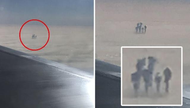 Пассажир авиалайнера сделал фото таинственных темных фигур, которые стояли на облаках