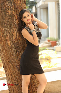 Actress Poojitha Pallavi Naidu Stills in Black Short Dress at Inkenti Nuvve Cheppu Movie Platinum Disc Function  0060.JPG