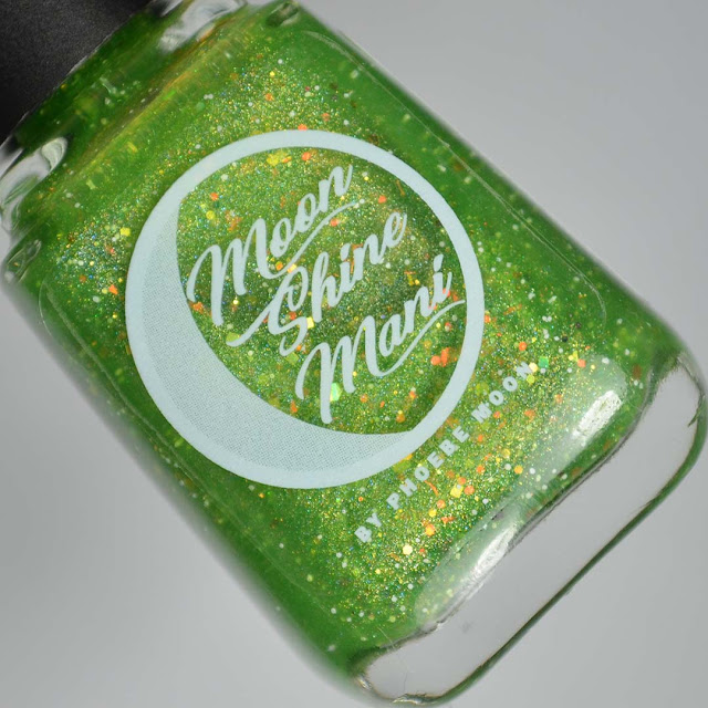 green nail polish with iridescent glitter