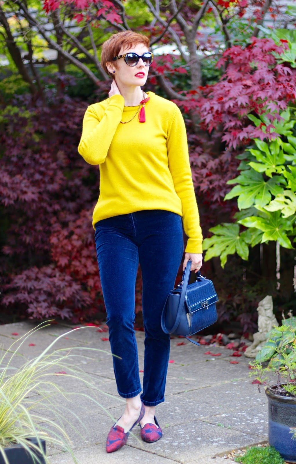 Kettlewell Yellow Jumper, Navy Velvet trousers, Embroidered Shoes | Fake Fabulous