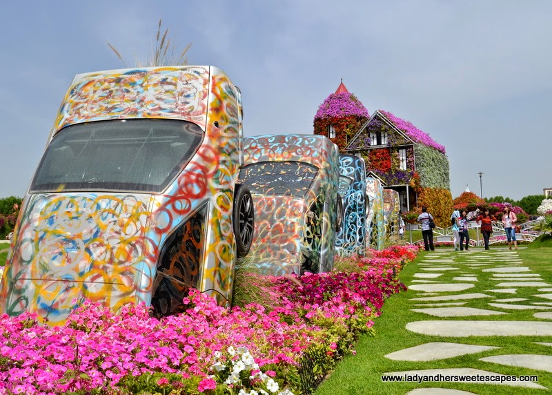 cottage and cars at Dubai Miracle Garden