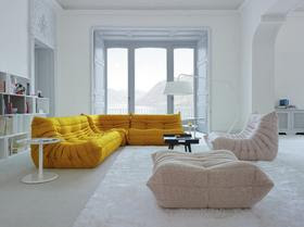 Bright Yellow ochre sofa with pale pink chairs in white room