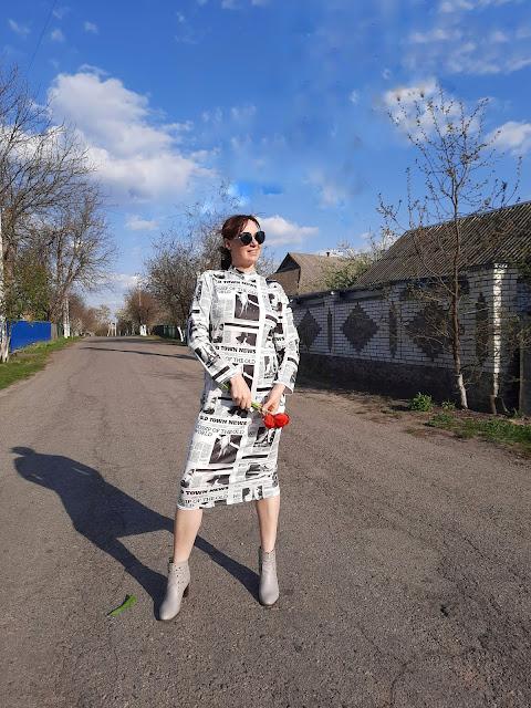 https://femmeluxefinery.co.uk/products/white-slinky-newspaper-print-high-neck-midi-dress-patrica