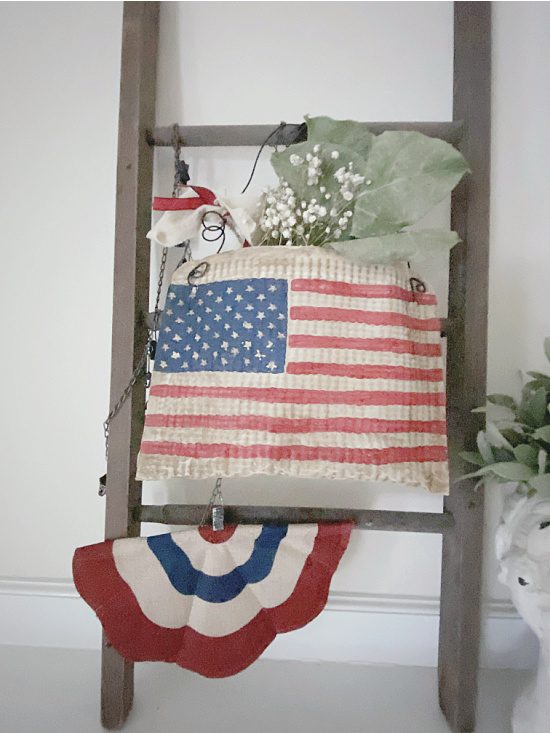 Mini mantel ladder with American flag pouch and a bunting