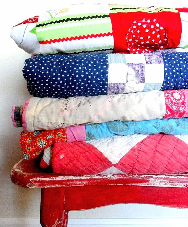 stack of patchwork blankets