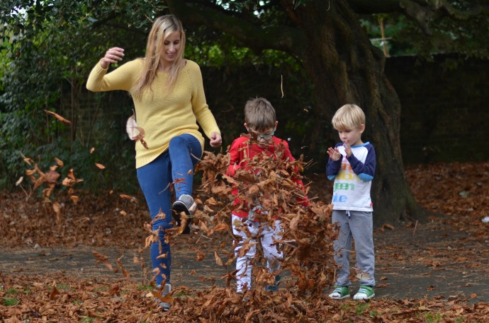 leaf kicking, Autumn activities with kids, strive footwear