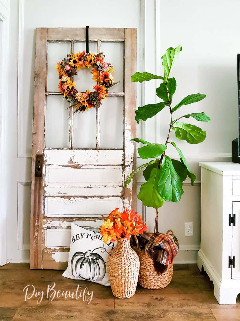 fall vignette with antique door and DIY wreath