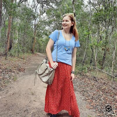 awayfromblue Instagram | blue v-neck tee and red printed maxi skirt
