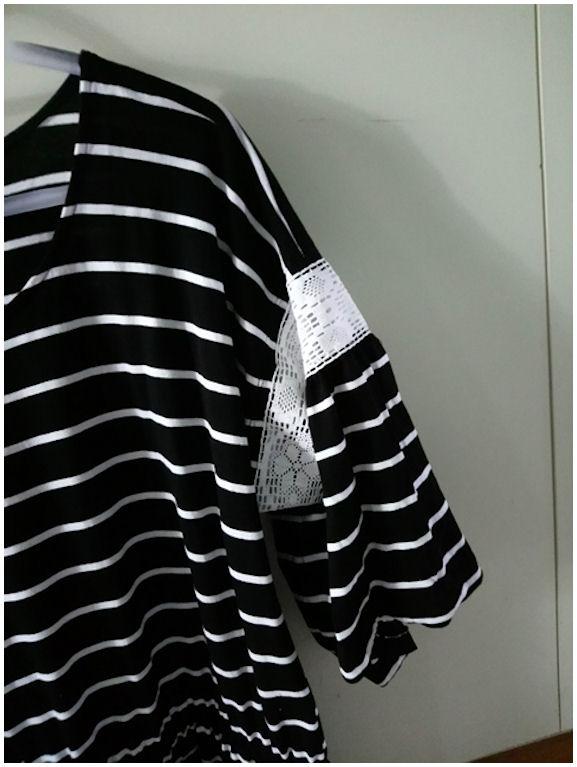 Mustavalkoisen puseron hiha - pitseineen.