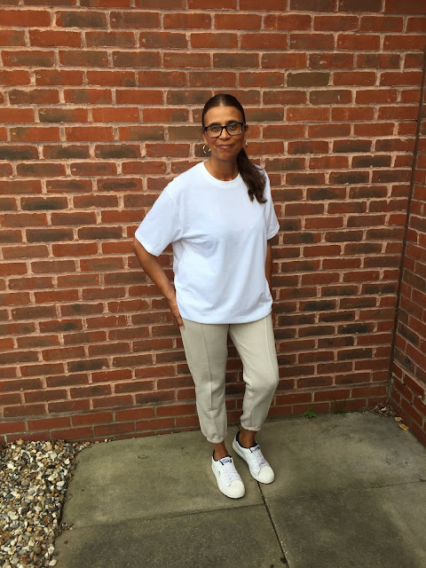 White crew neck oversized t shirt and stone seamed joggers